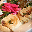 vegetarian selection of hummos, baba ghanouj, tabbouleh, feta cheese