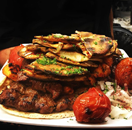 Kebabs served with Anteke bread, veggies and seasoned onions